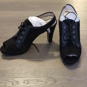 New peeptoe black heels